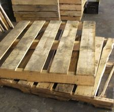 """This is what pallets look like around here. Not sure how """"decks"""" are made from this. I like the posts that show how they dealt with the gap"""