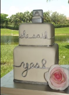 she said Yes! engagement cake - All edible including isomalt ring. Cake was chocolate Guiness with Bailey's swiss meringue buttercreme.The lettering continues around the entire cake as a silver band .