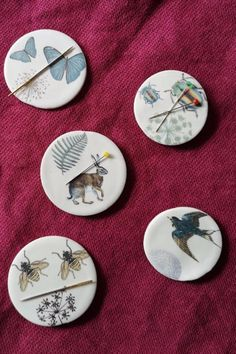 New from Caroline Barnes, these lovely ceramic needle minders have magnets on the back so your pins and needles be firmly held in place.  Another magnet goes on the other side of you fabric to hold the minder in place as you stitch.  Wear on your clothes or keep it to hand on your work as you stitch. #BeyondMeasure #sewing #keeper #bee #ladybird #hare Pins And Needles, Needle Minders, Hare, Magnets, Ceramics, Stitch, Sewing, Fabric, Couture