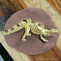 Dinosaur crafts are fun for young dino fans. This DIY Fossil Kit is easy to put together with homemade play dough. Give them out as dinosaur party favors.