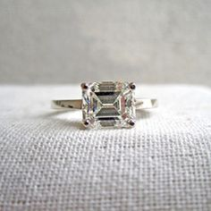 """One of my engagement ring obsessions is the east-west setting. This one updates a traditional emerald cut diamond with little embellishment. Another for the """"show my boyfriend"""" files!"""