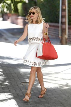 """The Perennially Polished Mom: Reese Witherspoon Reese Witherspoon is that  mom. You know: the one who never has a hair out of place, always wears her Sunday best, and constantly leaves you wondering, """"How does she do it?"""" Exhibit A: this midsummer outfit, consisting of a Lovers + Friends top and skirt, Kate Spade heels, and a Maiyet tote (matched to her lipstick, no less)."""
