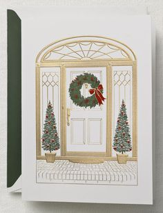 These were my Christmas cards last year.  Classic engraved wreath and topiary trees from Crane & Co. @crane.com