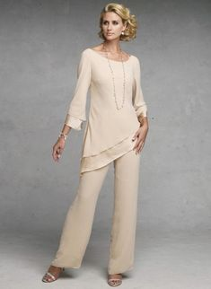 Two-piece chiffon and charmeuse pant set with hand-beaded trim, wide scoop neck blouse with two-tiered three-quarter length sleeves and matching two-tiered asymmetrically dropped waistline, straight leg pants.