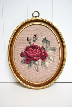 Set of 4. These framed needlepoint roses are beautiful. Beautiful pinks, mauves and fuschias stand out against the pale pink background. The entire image was worked and has been done with a thicker yarn, not floss. Someone spent a lot of time on these!    They have been mounted in oval frames that have a gold colored edging. These have not been professionally mounted and were most likely done by the maker.    They are in excellent condition. No stains, rips or tears.        SPECS:  14.5…