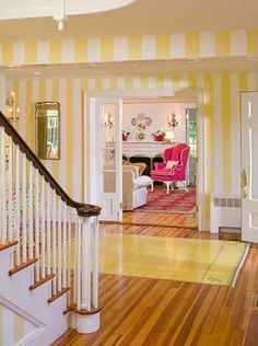 Yellow and white striped walls and...is that rug painted onto the floor? It is! Get the look of a rug, and never worry about tripping over flipped corners!