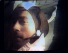 The third television transmission was made by the color television camera on the Apollo 10 spacecraft as the crew made their way to the moon. This image of astronaut John W. Young, Apollo 10 command module pilot, was made from that transmission.