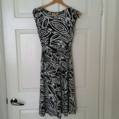 Black and white dress This dress has ruching in the front to make it tummy friendly. I wore this with hot pink heels to dinner on a cruise. Waist unstretched is 12.5 and length from top of shoulder to bottom is 40. It says size 6 but it fits more like a 4. Intermission Dresses
