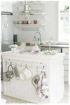Lovely white wire fruit basket, gorgeous cloche, stylish kitchen
