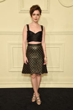 Collins kept it edgy, but simple in a matching bustier crop top and flared skirt. - MarieClaire.com