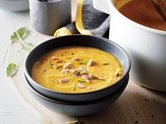 This fast recipe delivers slow-cooked flavor. Pumpkin is one of the few vegetables with a canned version that is quite good, saving you lots of time and effort. Just be sure you don't accidentally grab pumpkin pie filling (which will contain added sugar and spices). The soup holds up well, so you can make it a day or two ahead; if it waters out a bit after being reheated, just give it a good stir with a whisk. Roasted almonds perform double duty here: They're pureed into the soup to help…