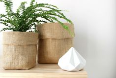 Natural Hessian | Pot Pouch | Fabric Pouch | Fabric Basket | Storage Basket  These pouches are great and versatile!  Use them as a pot pouch for your indoor plants and herb pots or in the office, bathroom, laundry and kitchen for all your storage needs. The pouches have a 4 corner base. You can adjust the top fold into any shape or style! SIZE: Small: 14cm (H) x 9cm (W) x 9cm (D) Large: 19cm (H) x 14cm (W) x 9cm (D)  FABRIC: Hessian  COLOUR: Natural  CARE: Warm Hand Wash, Drip Dry in Shade…