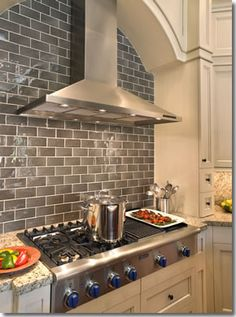 Grey Tile Backsplash. Handmade tiles can be colour coordinated and customized re. shape, texture, pattern, etc. by ceramic design studios