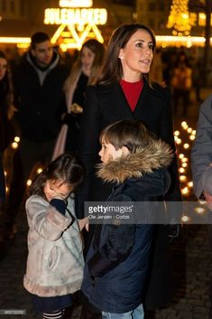 Princess Marie of Denmark and her children Princess Athena and Prince Henrik lights a candle in remembrance of World AIDS Day at Gammel Torv on December 1, 2017 in Copenhagen, Denmark. #remembrancecandles