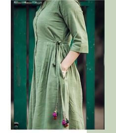Detailing with pleats,pocket,buttons patti and dori-latkan. Salwar Neck Designs, Kurta Neck Design, Dress Neck Designs, Kurta Designs, Blouse Designs, Frock Fashion, Hijab Fashion, Fashion Outfits, Indian Designer Suits