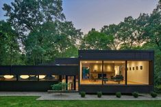 Interior renovation of a single family residence in the forests of Kalamazoo, Michigan by Mathison Architects - CAANdesign Modern House Facades, Modern House Design, Custom Home Builders, Custom Homes, Midcentury Modern, Glass Cabin, Modern Architects, Sweet Home, Home Landscaping