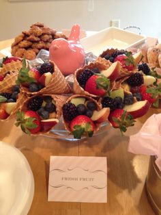 Waffle Cone fruit display. With fruit dip in serving bowl placed on side maybe a chocolate fountain. Love this lots of ways to play with it.