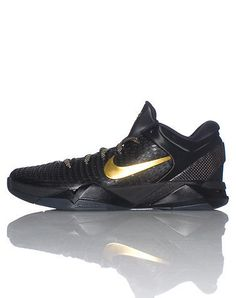 quality design f0877 647e3 NIKE The Kobe Bryants Medium top sneaker Lace up closure Carbon fiber style  side panels Signature swoosh on sides Cushioned sole for ultimate comfort