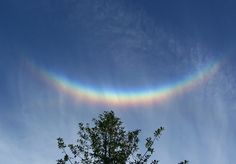 "Circumzenithal Arc. Sometimes called ""a smile in the sky."" One of the brightest, most colorful halos. Similar in appearance to a rainbow but it is actually formed from sunlight refraction through horizontally-oriented ice crystals not raindrops."