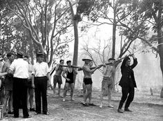 Locals help exhausted firemen fight bushfire at Sylvania,in southern Sydney 14 January 1939.