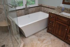 Portofino Tile is located in Cary, NC. This photo is one of the dream bathroom renovations we have completed in the local area. We ONLY do bathroom remodels, and finish complete bathroom renovations in less than two weeks. Call us at 919-432-4077 or visit our website at www.PortofinoTile.... We also have a showroom in Downtown Cary, NC at 115 Ward Street.