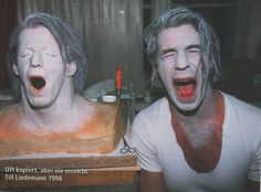 Till Lindemann posing by his fake head. This pic is from 1998, during the filming of the original 'Du riechst so gut' video.
