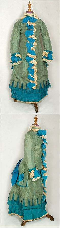 "young woman's silk bustle dress, c. 1870, Vintage Textile. It measures: 26"" chest, 24"" waist, 31"" hip, 13"" from sleeve cap to sleeve cap, and 36"" from the shoulder to the front hem. See: http://web.archive.org/web/20060126195347/http://www.vintagetextile.com/new_page_38.htm"