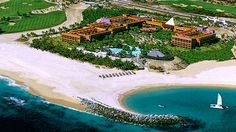 The all-inclusive beach and golf resort is nestled on a sandy cove along Los Cabos' stunning sapphire coast.