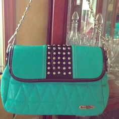 Free with Memorial Day special Cute teal black with rhinestone and silver studded handbag. My daughter used it a couple of times then it remained in her closet. Trying to clean out so what a better place to post- Poshmark. Bags
