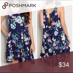 Stunning high low floral tank dress. Large Round Neck Sleeveless Floral Print High Low Dress in Navy. Gorgeous back detail. 100 rayon. Bust measures 42. Dresses Mini