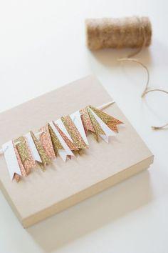 gift wrap with mini flags via ANASTASIA MARIE