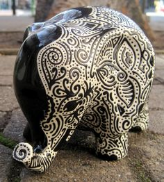 Lucky Elephant Bank -- Half Black, Half White with Flower Abstract $100 - This little guy would be perfect in my living room