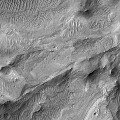 A Piece of Mars: HiRISE is celebrating 10 years of success by showcasing its first high resolution image, taken back in 2006. The portion shown here has many different ripple-like features, formed by a wind blowing from left to right. Notice that those in the middle and middle-left are a bit fainter: these are ripple-like features that were carved into the bedrock by the wind, and they may be much older than the sharper-edged ones nearby.