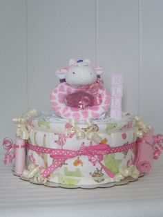 Baby Girl Diaper Cake Personalized Pink and Green Giraffe Safari Jungle Animals Theme. $34.99, via Etsy.
