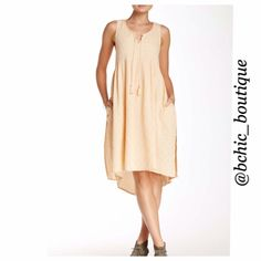 """JUST IN! Free People Peach Dress Free People Peach Hi-Low Dress  Split neck with tie closure  Sleeveless  Back Keyhole  2 front slip pockets  Allover texture  Hi-lo hem  Approx 38"""" shortest length, 44"""" longest length   Model stats for sizing  Height 5'8"""" Bust 34"""" Waist 24"""" Hips 34""""  Model wearing size Small  NO TRADES REASONABLE offers through offer button only Free People Dresses High Low"""