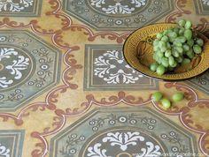 Decorative concrete floor designs - Italian-inspired SkimStone and Modello® stencil treatment with custom colors and OrnAll 131 http://www.modellocustomstencils.com/
