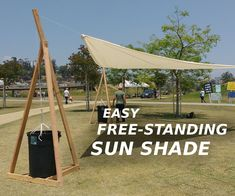 This sun shade is made of three free-standing towers, weighed down with large waste bins filled with water. The shade itself is strung between them. I built this. Backyard Shade, Patio Shade, Pergola Shade, Backyard Patio, Backyard Landscaping, Gravel Patio, Sun Sail Shade, Shade Sails, Shade Structure