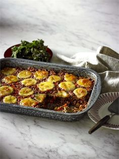 Veal and eggplant lasagne with roasted lemon kale