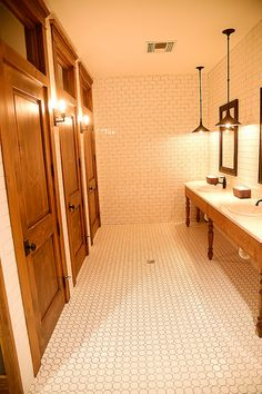Love the warm wood tones and cool tile look. Love the light fixtures too. / The Pioneer Woman, via Flickr