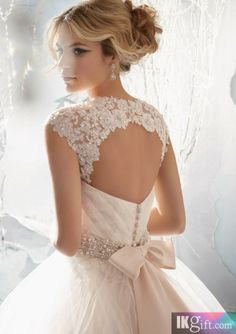 Love anything with an open back.  This dress is different as it has a ball gown silhouette :). Tulle is so romantic.  But might get hot in Miami.