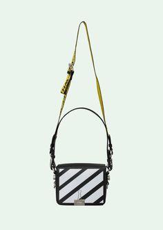 "Black Flap bag with white diagonals. Height 17cm. Width 19 cm. Depth 10 cm. Width shoulder strap 7 cm. Length ""TIE DOWN"" shoulder strap 162 cm."