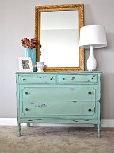 I love the distressed colored dresser and the big mirror.