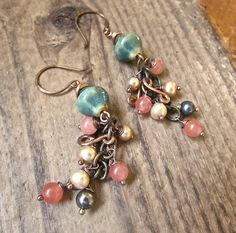Porcelain and pearl dangle earrings... A cascade of wire work freshwater pearls, copper and pink coral, with handcrafted ocean blue porcelain beads.