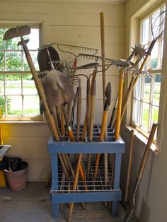 Love the square rack for the large work tools; such a good idea for keeping them upright, rather than leaning them against the wall, as I do, and getting bonked on the head because I've stepped on the tines of rake, mistakenly left pointing outward. ~ Slow Love Life: HANCOCK SHAKER VILLAGE: GARDEN SHED AND APOTHECARY