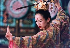 """House of the Flying Daggers (2004). """"During the reign of the Tang dynasty in China, a secret organization called """"The House of the Flying Daggers"""" rises and opposes the government. A police officer called Leo sends officer Jin to investigate a young dancer named Mei, claiming that she has ties to the Flying Daggers.""""  Stylized martial arts, rare and beautiful love, and I liked the scene in the bamboo forest which is very common in Chinese martial arts movies."""