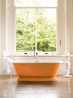 2012 Color: A Splash of Orange for Kitchen and Bath  Bring the energetic colors of citrus and sun to tub, counter, floor and more