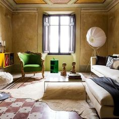 Exsqueeze me can we talk about how #perfect this room is? #interiorporn #milan #antiquewithmodern #ochre #midcenturymodern #cowhide #scandinavian