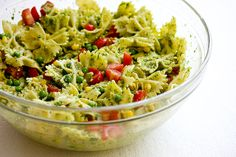 To make the Peanut Pesto and Peas Pasta Salad – boil some pasta, chop up some tomato, add some frozen peas, corn. Then toss with some of the peanut pesto. Really, that's it!