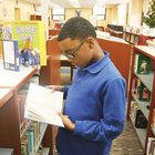 From staff reportsStaff photo by Britney LillyaSalem Middle School sixth-grade student Jihad Lamb, 12, reads a few pages while looking for a book at the new and improved Salem Middle School Library Media Center.TRENTON — The New Jersey Association of...