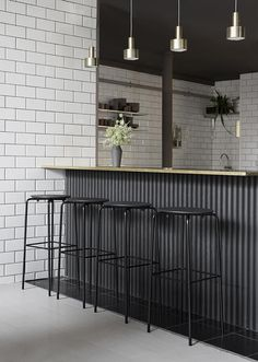 Restaurant IBU, Copenhagen, Denmark | The resulting design is a space of comfort, where touches from the home are in-keeping with Danish hygge and foster a welcoming and lingering environment. Warm, earthy tones are anchored by the all-black tables and chairs, patterned in such a way that the restaurant can host large parties as comfortably as it does date night #denmark #interiors #design #copenhagen #restaurantdesign